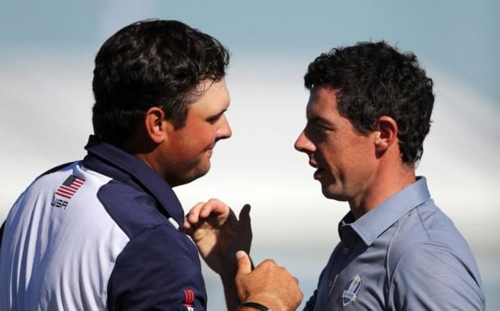 Patrick Reed and Rory McIlroy.jpg